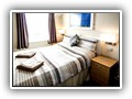 (Room 11) Double room at the front of the property located on the second floor, full shower en-suite.Panoramic foreshore and sea views.